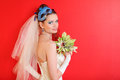 Bride with blue  mask in hairdo holds bouquet Stock Image