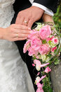 Bride bouque and rings on hands Stock Image