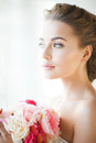 Bride with bouquet of flowers lovely indoors Stock Image