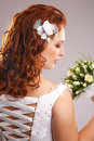Bride with bouquet profile of beautiful red hair Stock Photography