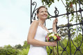 Bride With Bouquet Standing By Gate Stock Photography