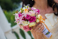 Bride and bouquet wedding bouquet in the hands of the holding a Royalty Free Stock Images