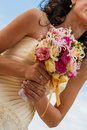 Bride and bouquet wedding bouquet in the hands of the holding a Royalty Free Stock Photo