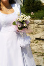 Bride and bouquet wedding bouquet in the hands of the holding a Royalty Free Stock Photos
