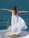 Bride on the bow of a boat Stock Photo