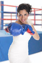 A bride with boxing gloves as a sign of struggle Stock Photography