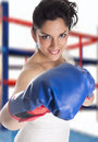 A bride with boxing gloves as a sign of struggle Stock Photos