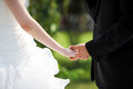 Bride and bridegroom hand in hand Royalty Free Stock Photo