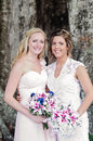 Bride and bridemaid bridesmaid holding bouquets Royalty Free Stock Photo