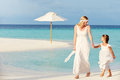 Bride bridesmaid beautiful beach wedding holding hands Royalty Free Stock Image