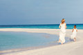 Bride bridesmaid beautiful beach wedding running Stock Image