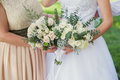 Bride and bridesmaid with bouquets Royalty Free Stock Photo