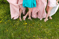 Bride and bridesmaids legs barefoot Stock Image