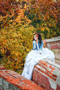 Bride in city park beautiful wedding dress and denim jacket autumn Royalty Free Stock Image