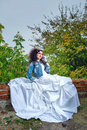 Bride in city park beautiful wedding dress and denim jacket autumn Stock Images