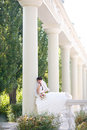 Bride in columns Stock Photo