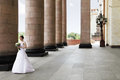 Bride and columns with bunch of flowers standing at the big Royalty Free Stock Photos