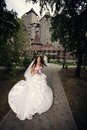 Bride dancing in the park Stock Photo