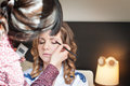 Bride is doing make up for wedding celebration Royalty Free Stock Photo