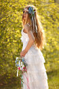 Bride dressed hippie style stands outdoors spring park Royalty Free Stock Photography