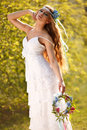 Bride dressed hippie style stands outdoors spring park Stock Image