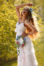 Bride dressed hippie style stands outdoors spring park Stock Images