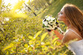 Bride dressed hippie style stands outdoors spring park Stock Photo