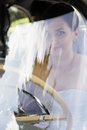 Bride driver sitting at the wheel of oldsmobil car Stock Photography