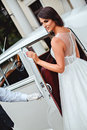 Bride entering classic car Royalty Free Stock Photo