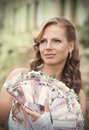 Bride with a fan portrait of smiling decorated lace and flowers looking away Stock Images