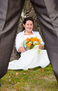 Bride flirting with new husband newlyweds having fun in outdoor scenery Royalty Free Stock Images