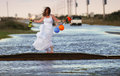 Bride at flooded event north carolina strange site of a standing on part of a road after a tropical storm the roadways on the Royalty Free Stock Images