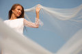 Bride with flying veil young cheerful is holding her selective focus Royalty Free Stock Photo