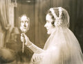 Bride gazing into hand mirror Royalty Free Stock Photo
