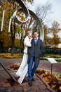 Bride and groom about art ironwork Royalty Free Stock Photo