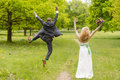 Bride and groom beautiful jumping on a green meadow Royalty Free Stock Photos