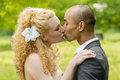 Bride and groom beautiful kissing on a green meadow Royalty Free Stock Photos