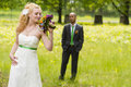 Bride and groom beautiful standing on a green meadow Stock Photo