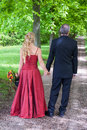 Bride and groom from behind are walking together on their common way of life Royalty Free Stock Photo