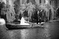 Bride and groom in boat black white photo of beautiful rowing Royalty Free Stock Photography