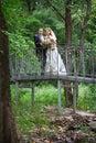 Bride and groom on bridge Royalty Free Stock Image