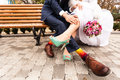 Bride and groom in bright clothes on the bench Stock Image