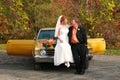 Bride and groom on car Stock Photos