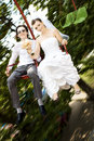 Bride and groom on carousel Royalty Free Stock Photo