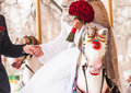 Bride and groom in a carousel on their wedding day Royalty Free Stock Photo