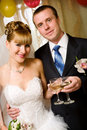 Bride and groom with champagne Royalty Free Stock Images