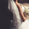 Bride and groom closeup, veil wedding dress Royalty Free Stock Photo