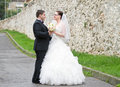 Bride and groom couple posing outdoors Stock Photo