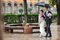 Bride and groom couple walking together in a rainy day Stock Images