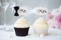 Bride and groom cupcakes for a wedding Stock Photos